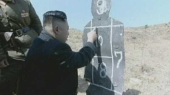 Kim Jong-Un checks his handiwork on the target