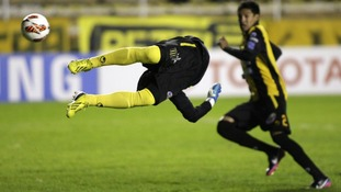 Bolivia's The Strongest goalkeeper Daniel Vaca tries to stop the ball against Brazil's Sao Paulo FC