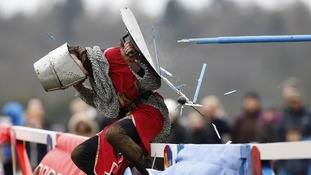 A performer dressed as a squire is hit with a lance at the annual jousting tournament at Knebworth House in Hertfordshire