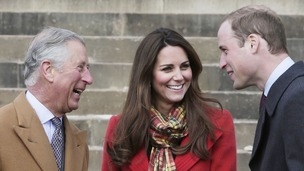 Kate wore a red Armani coat and yellow tartan scarf for her visit to Dumfries House