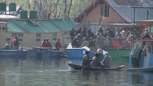 Police remove the body of a British woman from a houseboat on Dal Lake in Srinagar, Kashmir