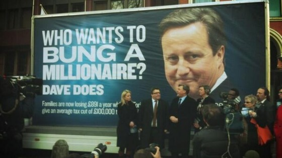 Labour unveil their new poster to mark the reduction in the 50p tax rate.