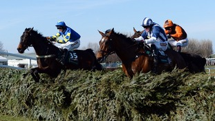 Auroras Encore and Ryan Mania (left) jump into the lead at the final fence