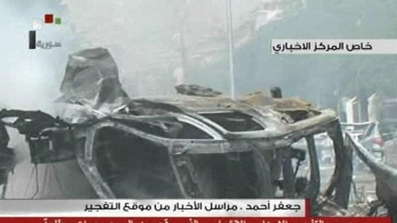 Rubble and burned out cars have been seen on local television after a huge car bomb in central Damascus