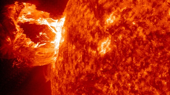 The solar flare eruption; a sudden release of magnetic energy. 