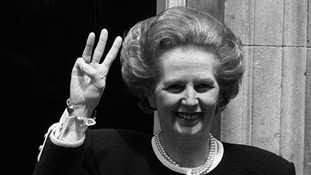 Prime Minister Margaret Thatcher giving a three-fingered salute outside 10 Downing Street as she begins her third successive term