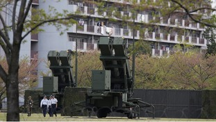 Units of Patriot Advanced Capability-3 (PAC-3) missiles stand in front of a housing complex, at the Defence Ministry in Tokyo