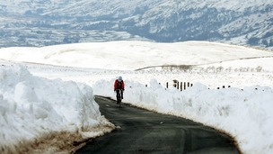 A cyclist braves the snow near Reeth in the Yorkshire Dales in March 2013