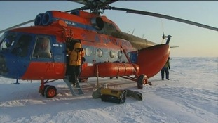 Stepping out of the helicopter near the North Pole