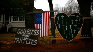 Tributes left to the victims of the shooting at Sandy Hook Elementary School in Newtown, Connecticut