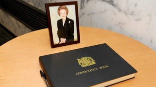 A condolence book along with Baroness Thatcher's portrait
