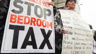 Protestors take part in a demonstration outside Croydon Town Hall in Surrey, against the government's proposed 'Bedroom Tax'.