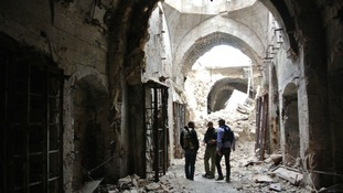 Free Syrian Army members patrolling inside the Great Mosque in Aleppo.
