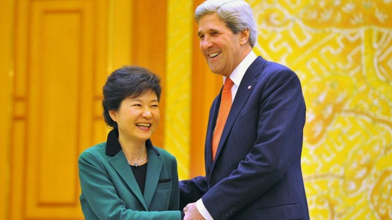South Korean President Park Geun-Hye and US Secretary of State John Kerrry shake hands.
