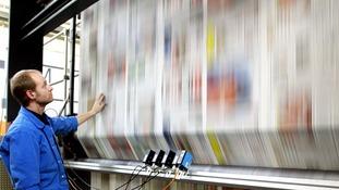 Man at printing press