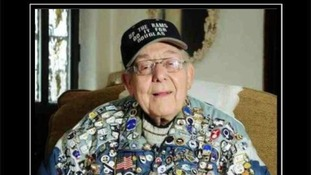 Douglas Else proudly wearing his badge collection