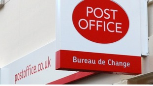 A Post Office sign.