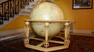 A finely-crafted wooden globe given as a gift to Lady Thatcher from French President Francois Mitterrand during a visit to Britain.