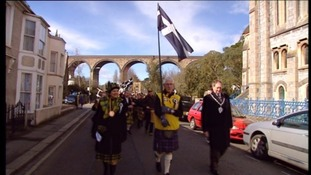 Marching for St Pirans day wearing Cornish tartan