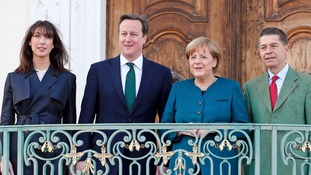 German Chancellor Angela Merkel and her husband Joachim Sauer welcome Britain's Prime Minister David Cameron and his wife Samantha.