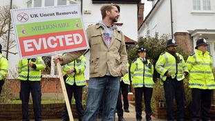 Protests took place outside what is believed to be Lord Freud's home.