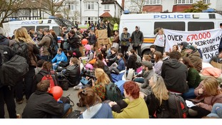Protesters sit outside the property in Highgate, North London.