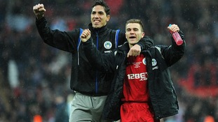 Wigan players Joel Robles and Callum McManaman celebrate the win