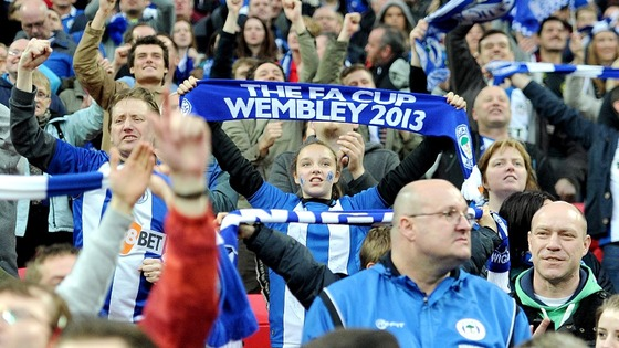 Wigan fans failed to sell their full allocation of tickets, but no one seemed to care at full-time 