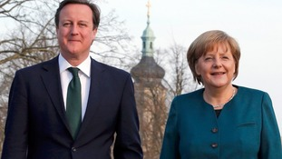 Prime Minister David Cameron and Chancellor Angela Merkel in Schloss Meseberg.