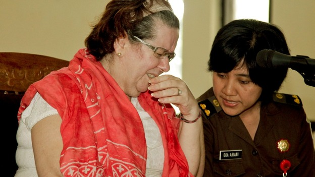 Lindsay June Sandiford talks to an translator during her first trial in Denpasar Court, Denpasar, Bali.