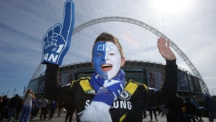 A young Chelsea fan arrives at Wembley Stadium ahead of the game