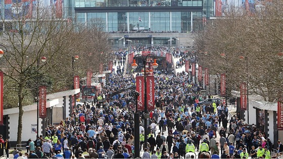 Fans make their way in to Wembley Stadium