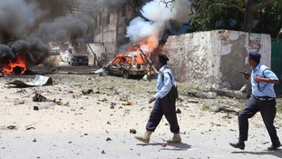Somali policemen take up position near the scene of a deadly blast in Mogadishu.