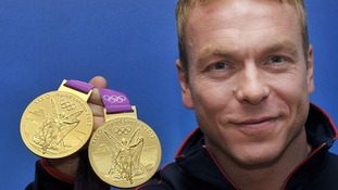 Sir Chris Hoy with two of his Olympic gold medals
