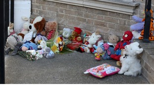 Tributes lay outside the house in Lowestoft where three children were found dead.