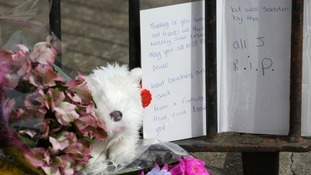 Tributes left outside the house in Lowestoft where three children were found dead.