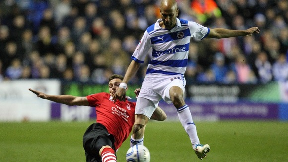 Reading's Jimmy Kebe (right) in action against Nottingham Forest's Paul Anderson