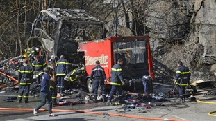 French fire brigade members work around the debris from the crashed bus.