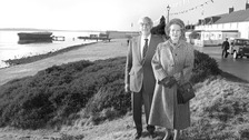 Margaret Thatcher and her husband Dennis standing on Victory Green in Port Stanley on the Falkland Islands.