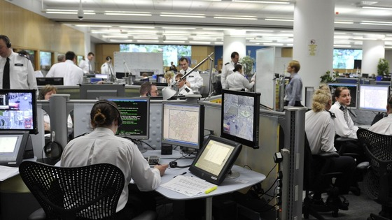 Officers watch screens at the Metropolitan Police's Specialist Operations Room in Lambeth, south London