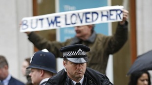 A supporter of Margaret Thatcher lines the route of her funeral procession, outside St Paul's cathedral, London