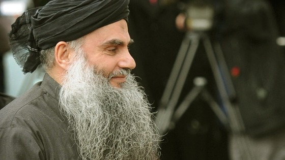 Abu Qatada arriving at his London home after leaving Long Lartin high security prison in Evesham, last year.