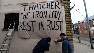 Residents from mining communities near Barnsley put out banners.