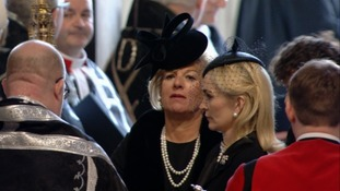 Carol Thatcher is seen behind Sarah, Mark thatcher's wife in the entrance to St Paul's.