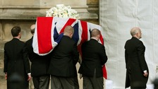 Pallbearers carry the coffin of former British prime minister Margaret Thatcher into the Palace of Westminster