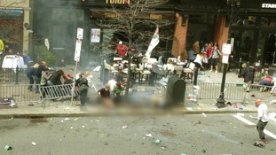 Image of the same section of Boylston Street taken after the blast