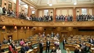 Members of the New Zealand Parliament sing after Same Sex Marriage bill passes