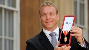 Chris Hoy with the Knighthood he received from the Prince of Wales during the investiture ceremony at Buckingham Palace.