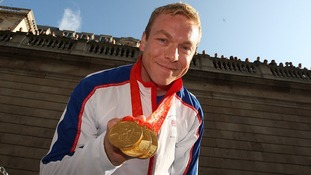 Sir Chris Hoy chows off his hat-trick of Gold from the 2008 Beijing Olympics.