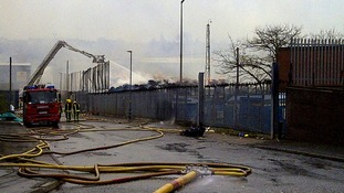 Firefighters continue to try and douse the flames at a paper mill.